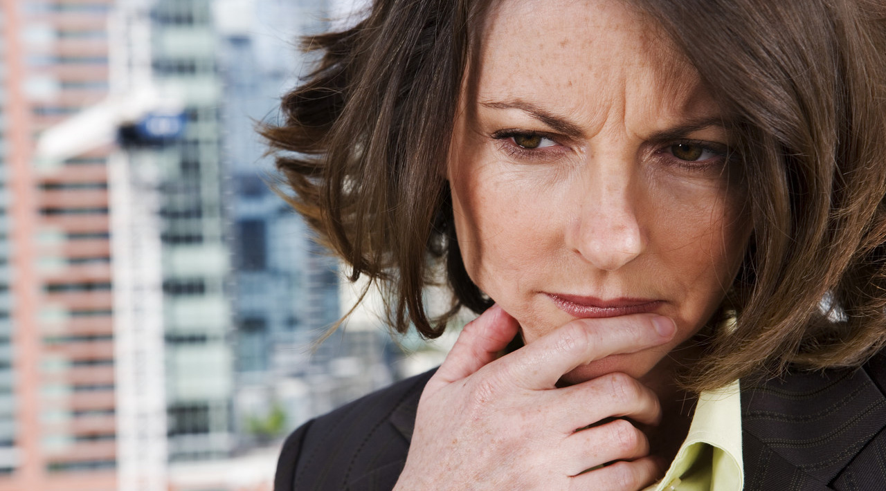 Pensive Businesswoman Downtown --- Image by © Royalty-Free/Corbis